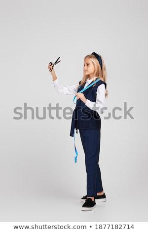 Női szabó tart mérőszalag olló közelkép Stock fotó © deandrobot