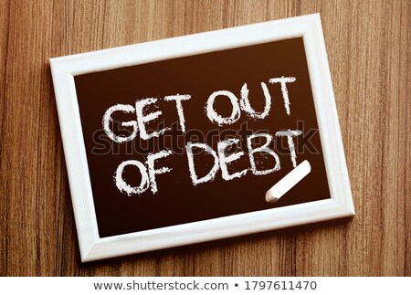 get out of debt on black board stock photo © fuzzbones0