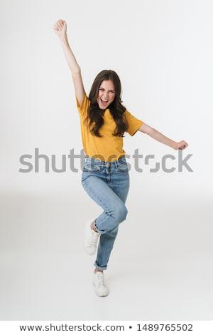 pretty woman posing smiling at camera stock photo © wavebreak_media