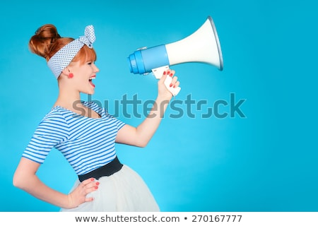 Hand of woman with megaphone. Stock photo © Kurhan