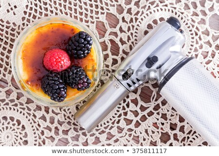 freshly prepeared creme brulee with berries stock photo © ozgur