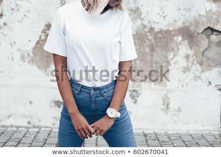 Fiatal szőke nő fehér rövidujjú póló bugyik nő Stock fotó © user_9834712