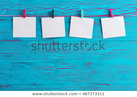 Four blank white notepads on blue crackle paint Stock photo © ozgur