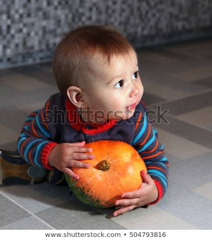 little boy holding not big pumpkin Stock photo © ssuaphoto