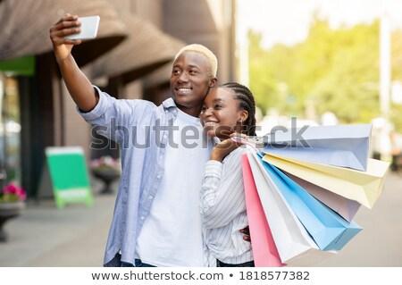 African cheerful man make a selfie outdoors. Stock photo © deandrobot