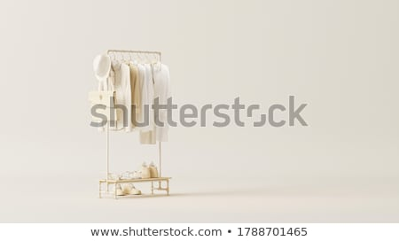 Fashionable clothes on hangers in store Stock photo © RuslanOmega