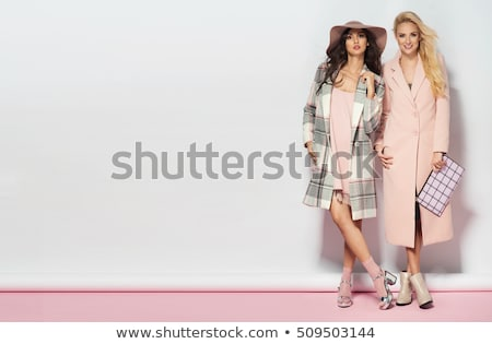 Fashion photo of fashionable woman in pink coat with handbag wea Stock photo © Victoria_Andreas