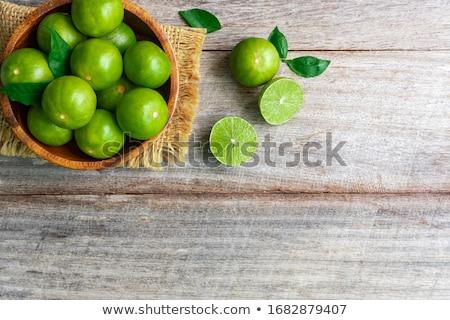 Green Limes Stock photo © BrandonSeidel