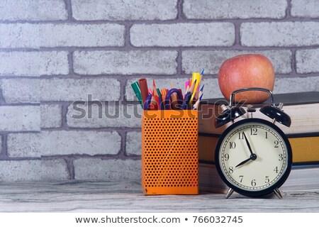 Kitaplar çalar saat elma kalem ahşap masa Stok fotoğraf © wavebreak_media