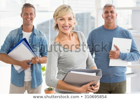 Smiling business colleagues holding workbooks Stock photo © wavebreak_media