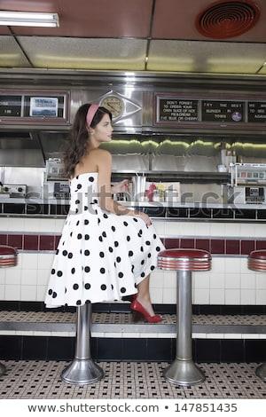 Grave jóvenes casual mujer sesión taburete Foto stock © feedough