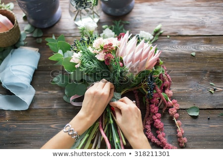 Woman arranging a flower bouquet Stock photo © IS2