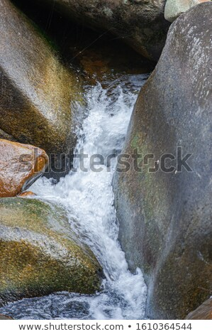 waterfall coming down the brown rocks stock photo © bluering