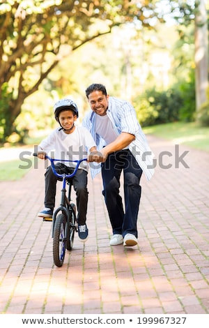 A father teaching his son how to garden Stock photo © IS2