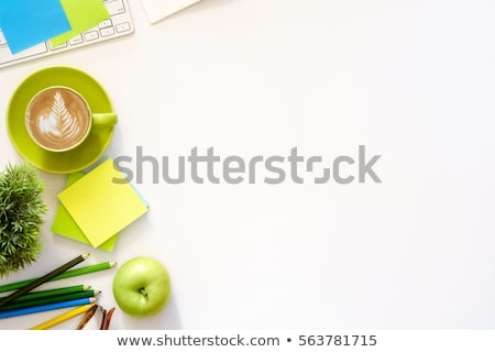Books and an apple on top of a desk Stock photo © IS2