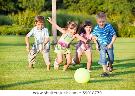 Stock photo: Children playing ball in a park