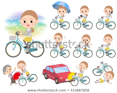 Behind knot hair yellow skirt woman ride on city bicycle Stock photo © toyotoyo