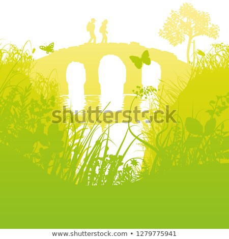 Hikers crossing an old bridge over a brook Stock photo © Ustofre9