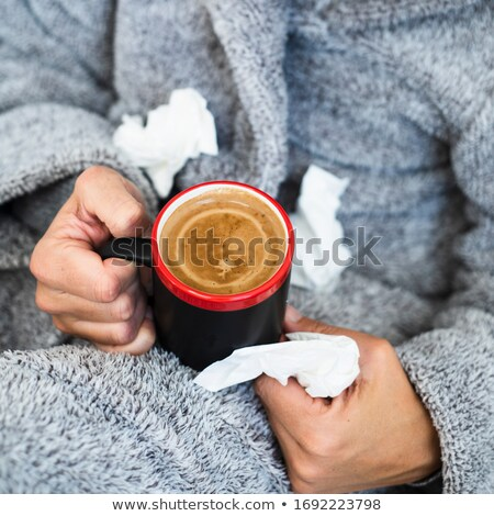 ill man warming up with a cup of hot coffee Stock photo © nito
