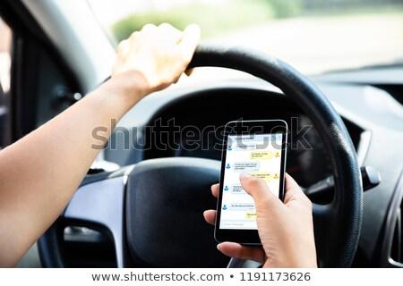 Stockfoto: Vrouw · smartphone · rijden · auto