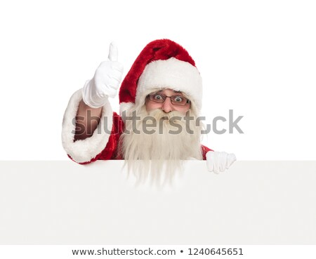 old saint nick holds empty billboard and makes ok sign Stock photo © feedough