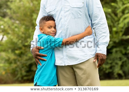 Stock photo: Beautiful portrait of a cute little boy hugging his dad