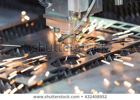 cnc laser cut machine cutting the sheet metal stock photo © boggy