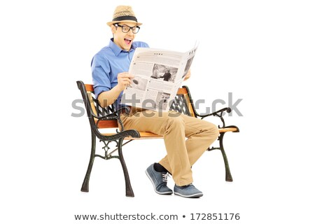 seated man reading newspaper is shocked by the news stock photo © feedough