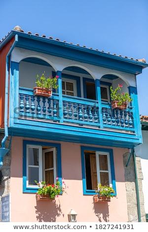 Tradizionale legno balcone pietra facciata tipico Foto d'archivio © boggy