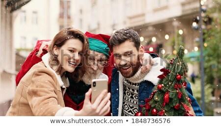 close up of senior man picturing wife at christmas stock photo © dolgachov