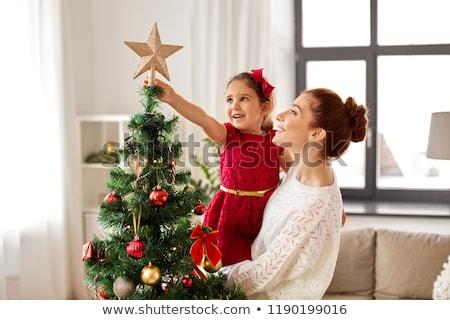 Boldog lány piros karácsonyfa karácsony ünnepek gyermekkor Stock fotó © dolgachov