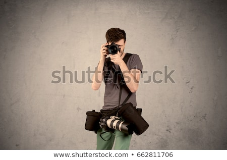 Hand photo shooting an empty grey wall Stock photo © ra2studio
