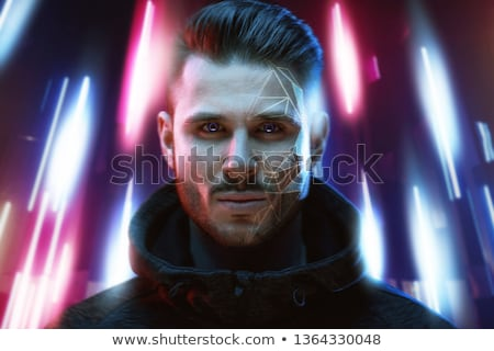 Young man on dark background, face recognition concept Foto d'archivio © ra2studio