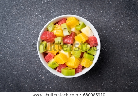 close up of citrus in bowls fruits on stone table Stock photo © dolgachov