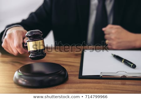 Gavel on sounding block at courtroom for decide home insurance,  Stock photo © Freedomz