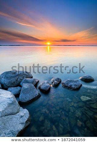 Belle coucher du soleil mer derrière roches ciel Photo stock © galitskaya