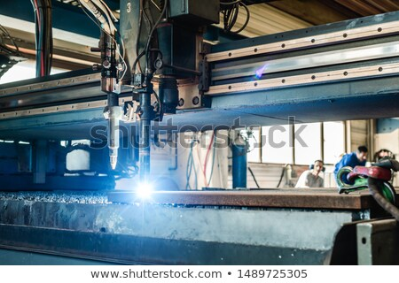 Plasma cutter in a factory cutting piece of metal Stock photo © Kzenon