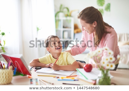 Schoolboy Doing Homework Assignments at Lesson Stock photo © robuart
