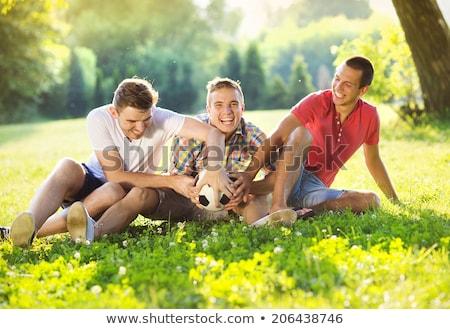 Boldog barátok szabadidő együtt mező három Stock fotó © Lopolo