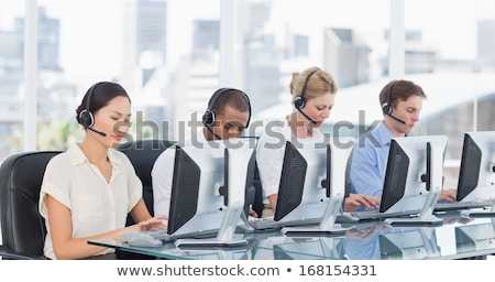 Front view of young well dressed Asian businessman speaking to business professionals sitting at bus Stock photo © wavebreak_media