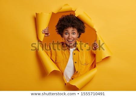 Happy Afro American woman with curly hairstyle, looks through documents, prepares financial report,  Stock photo © vkstudio