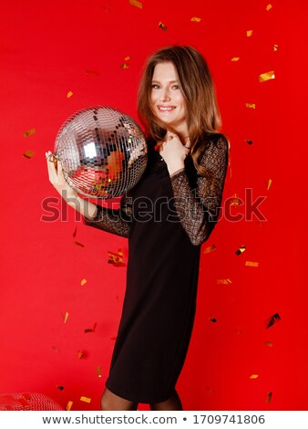 Restful young woman in black glittering dress holding disco ball Stock photo © pressmaster