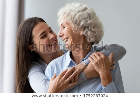 Happy mother and daughter have fun, embrace and express love to each other, dressed in casual wear,  Stock photo © vkstudio