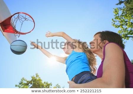 Bambina giocare basket parco giochi cielo estate Foto d'archivio © Lopolo