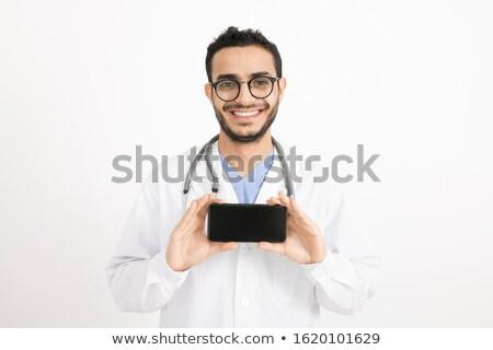 Derűs fiatal orvos mosoly fogakkal fényképezés okostelefon Stock fotó © pressmaster
