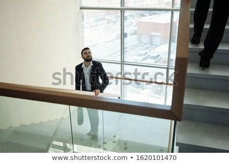 Jungen eleganten bärtigen Geschäftsmann Handtasche Obergeschoss Stock foto © pressmaster