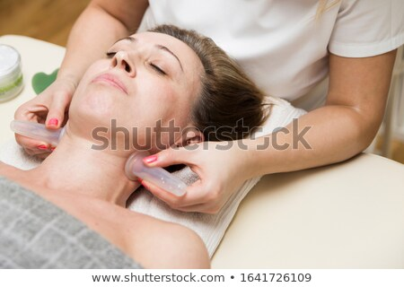 Cup applied to neck skin of a female patient as part of the trad Stock photo © boggy
