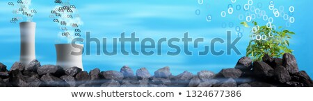 Coal power plant with black coal behind it Stock photo © ShustrikS