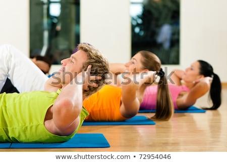 Exercising Abdominals In Fitness Club Stock photo © Jasminko