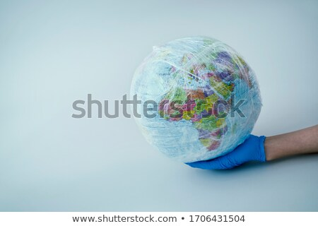 man with a world globe wrapped in plastic Stock photo © nito